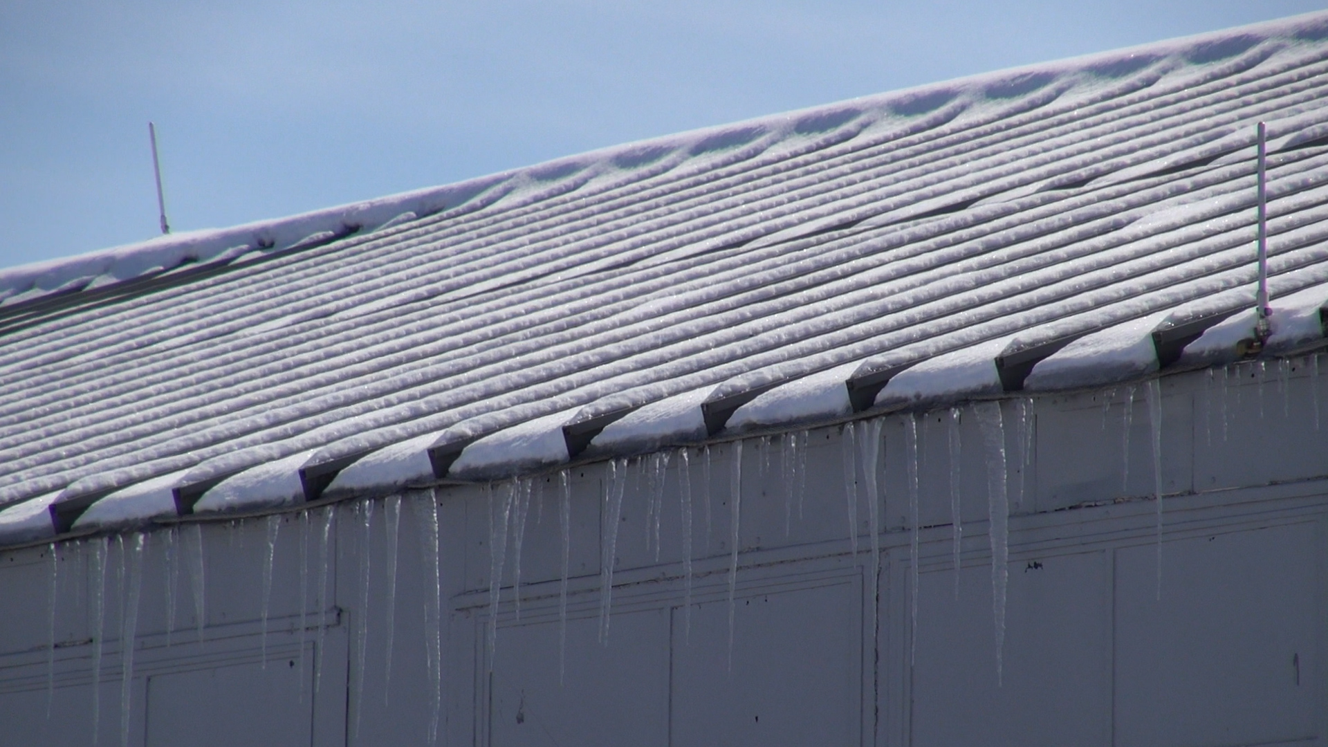 snow and ice on a roof