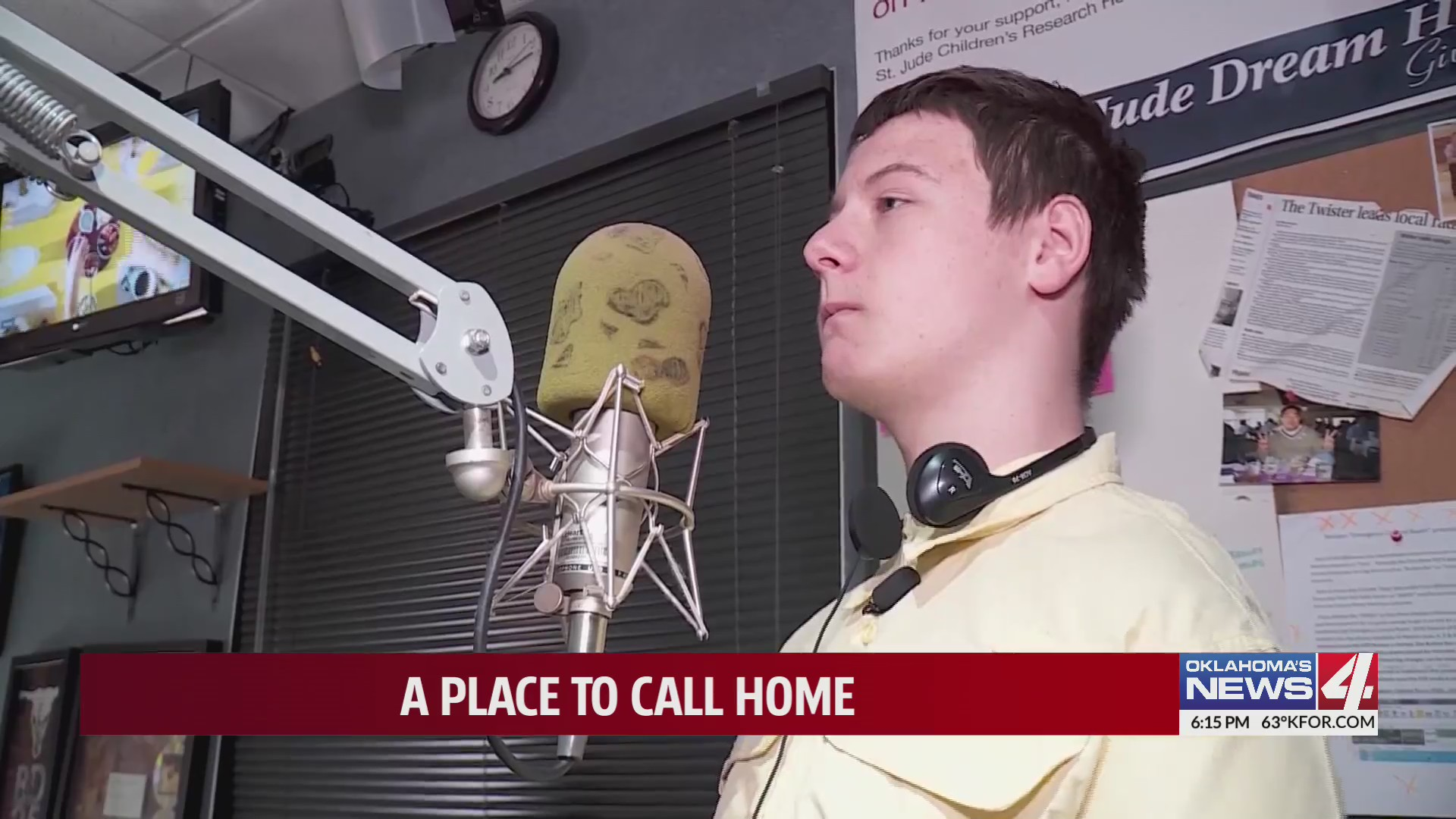 15-year-old Josh stands in front of radio microphone
