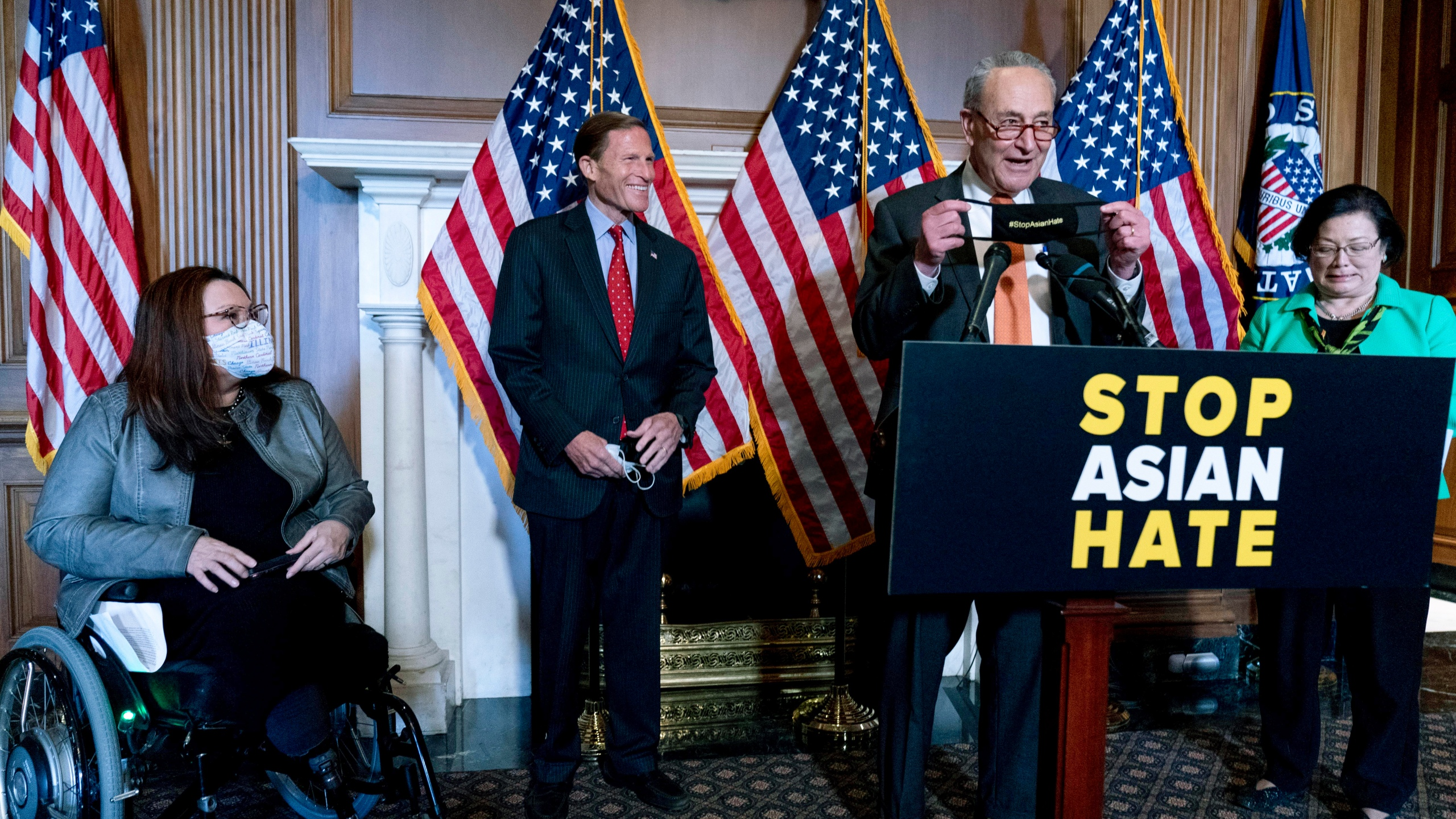 Senate Majority Leader Chuck Schumer of N.Y., accompanied by Sen. Mazie Hirono, D-Hawaii, Sen. Tammy Duckworth, D-Ill., and Sen. Richard Blumenthal, D-Conn., speaks at a news conference after the Senate passed a COVID-19 Hate Crimes Act on Capitol Hill, Thursday, April 22, 2021, in Washington. (AP Photo/Andrew Harnik)