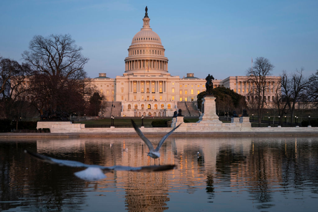The U.S. Capitol building exterior is seen at sunset on March 8, 2021 in Washington, DC. (Photo by Sarah Silbiger/Getty Images)
