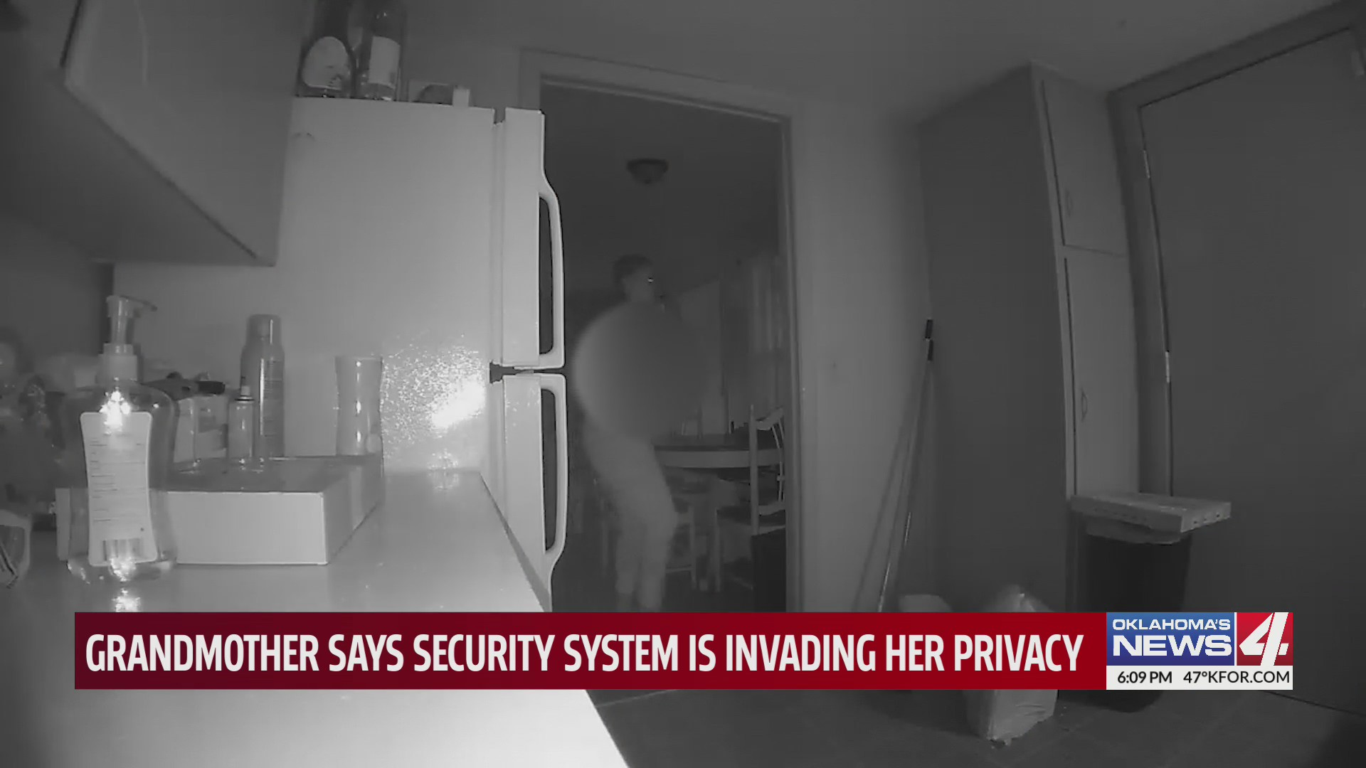 Woman standing in her own home, as filmed by her security camera