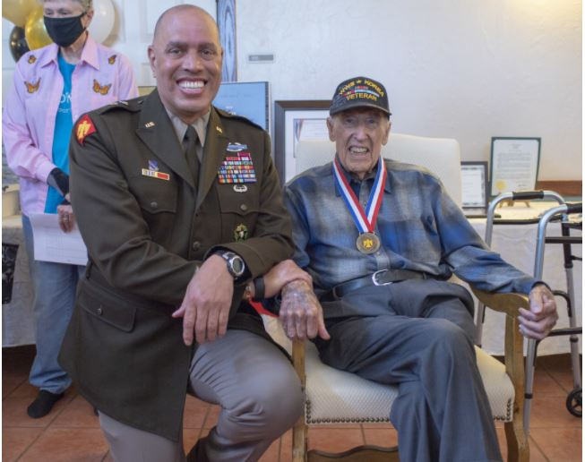 Maj. Gen. Michael Thompson, adjutant general for Oklahoma, poses with Lt. Col. (Ret.) Oren L. Peters, World War II and Korean War Veteran from the renowned 45th Infantry Division, Saturday, April 10, 2021, during a Thunderbird Medal presentation ceremony. The Thunderbird Medal is the Oklahoma National Guard's highest award presented to a civilian and was presented to Peters for his distinguished military service. (Oklahoma National Guard photo by Lt. Col. Geoff Legler)