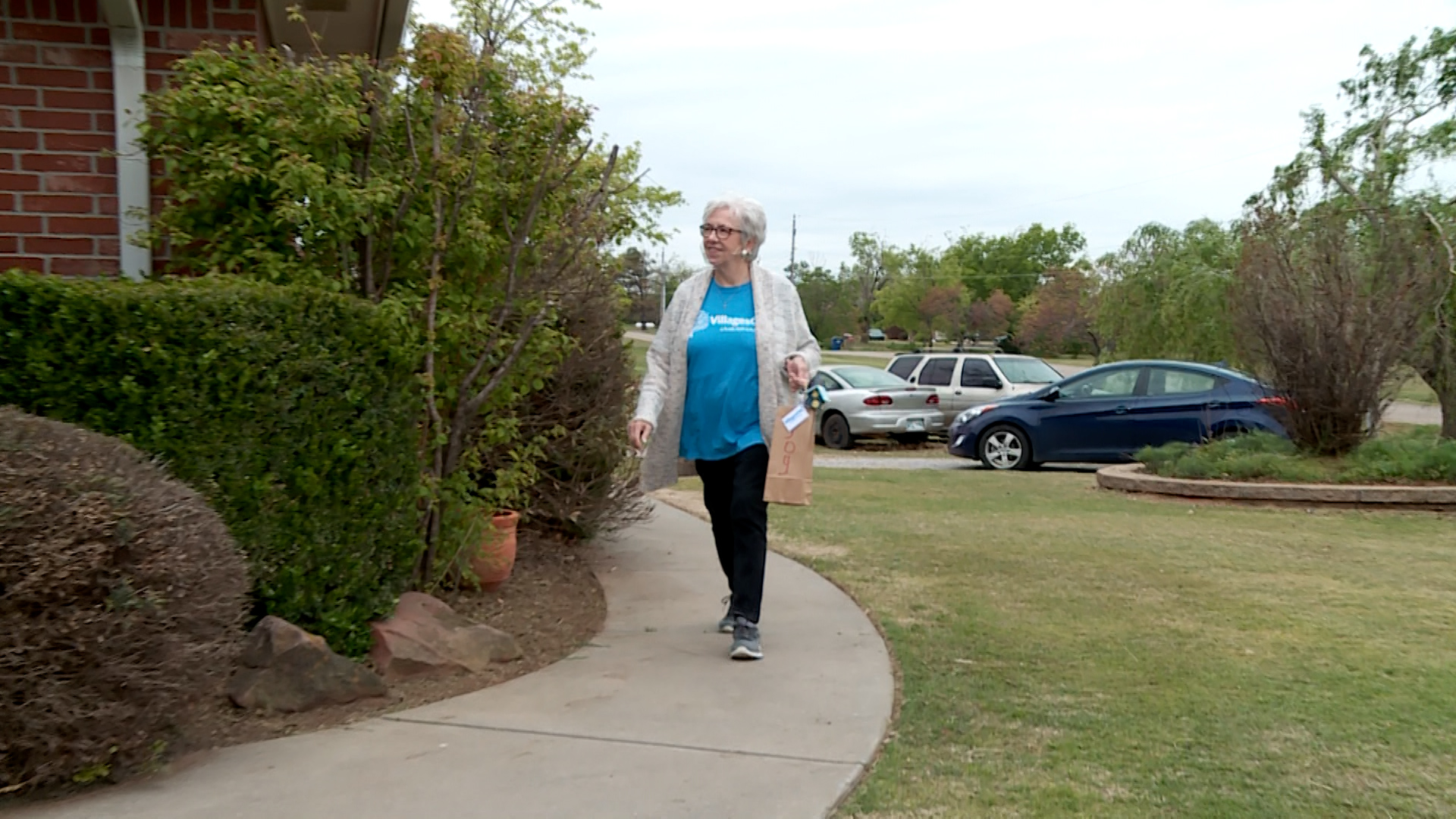 VillagesOKC volunteer makes a Porch Pals delivery.
