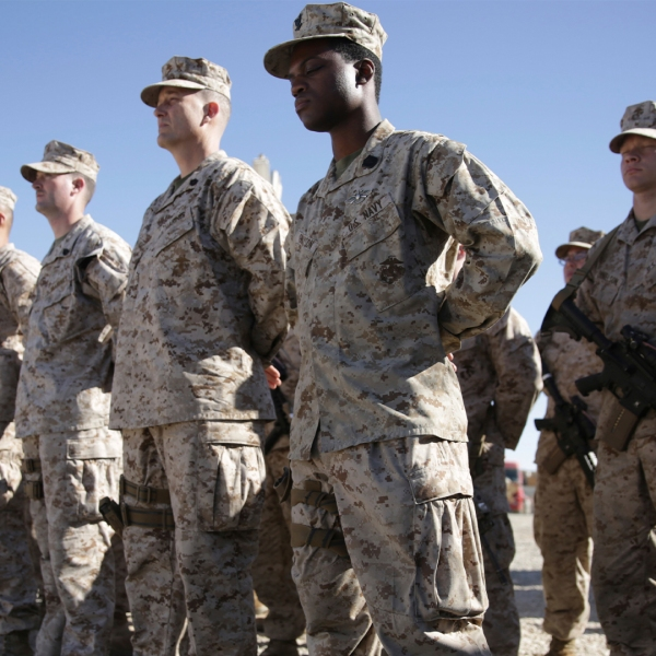 n this Jan. 15, 2018, file photo, U.S. Marines watch during the change of command ceremony at Task Force Southwest military field in Shorab military camp of Helmand province, Afghanistan. (AP Photo/Massoud Hossaini, File)