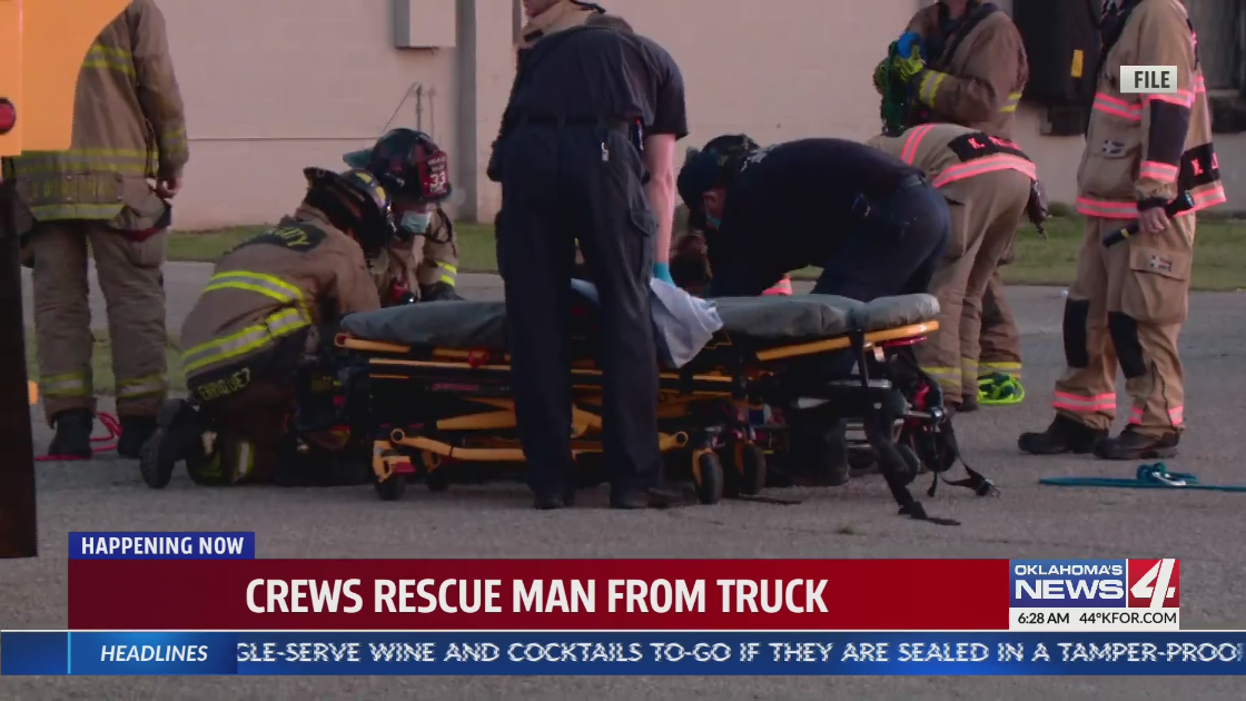 Crews rescue man from truck