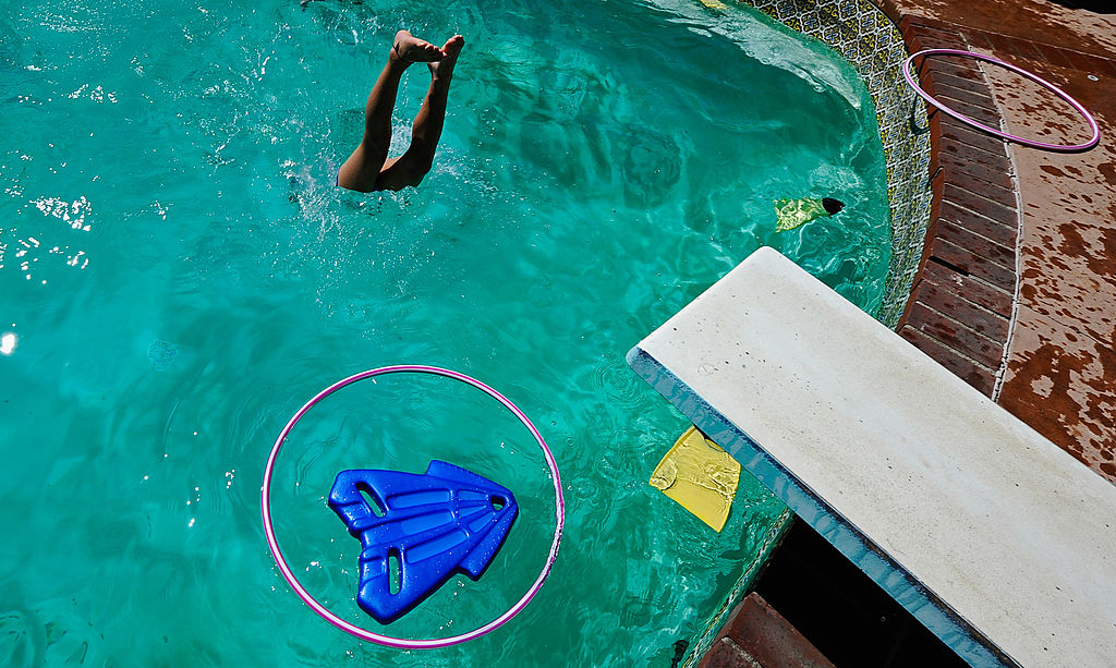 A child plays in a backyard pool on August 25, 2010 in Los Angeles, California