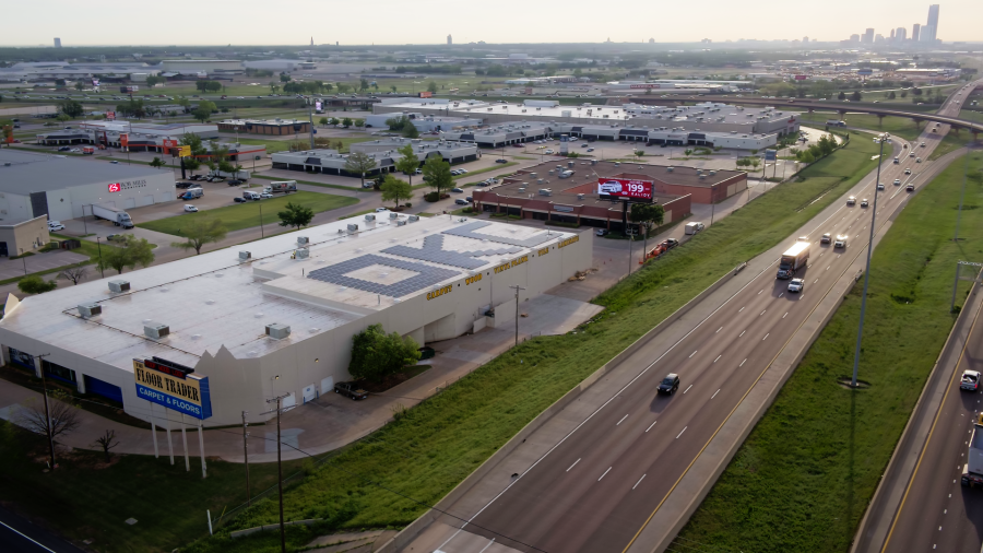 Image of the roof of a business spelling OKC
