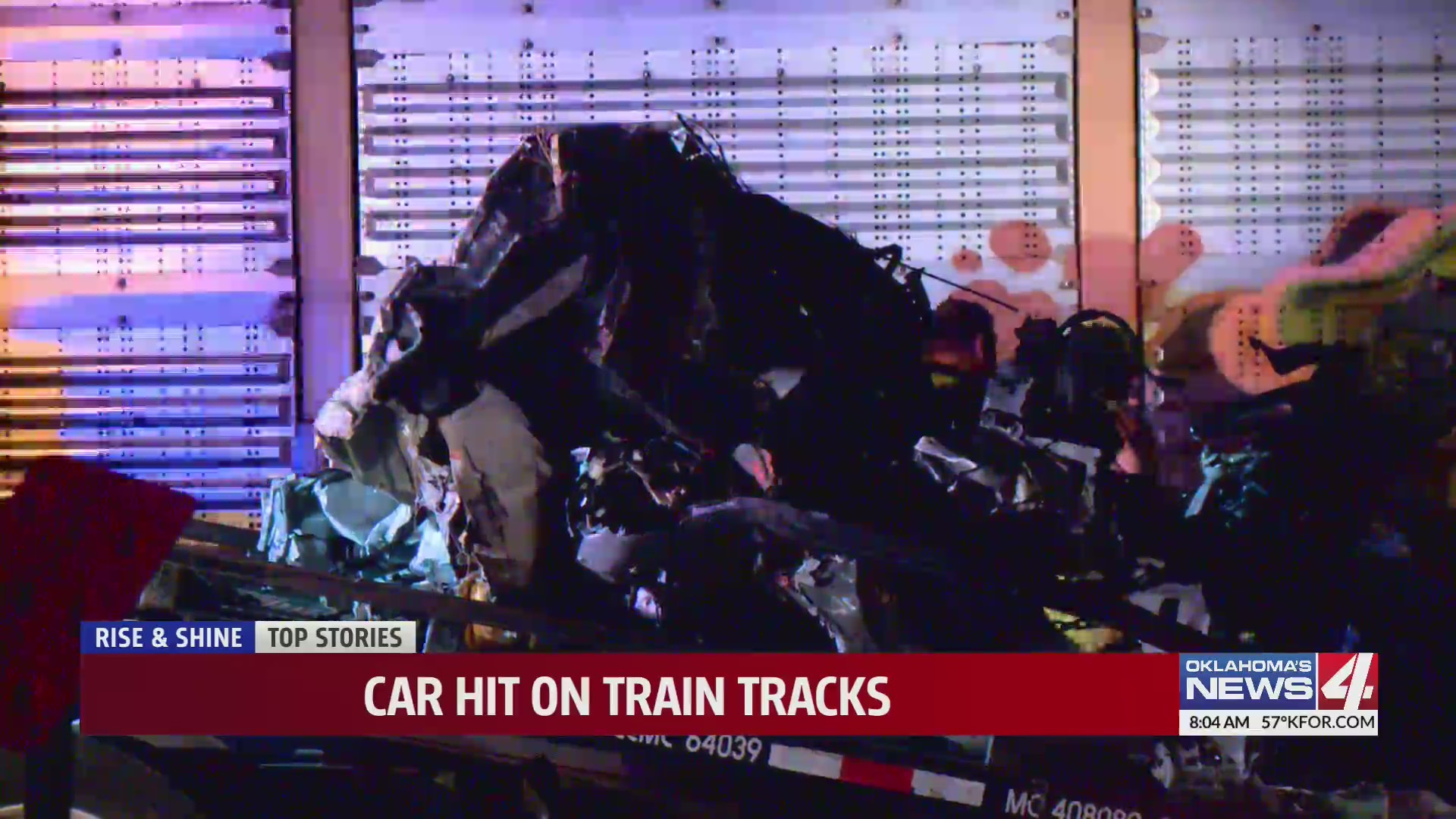 car sandwiched between trains