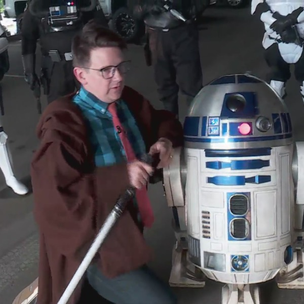 image of Lucas Ross with R2D2 on May 4th