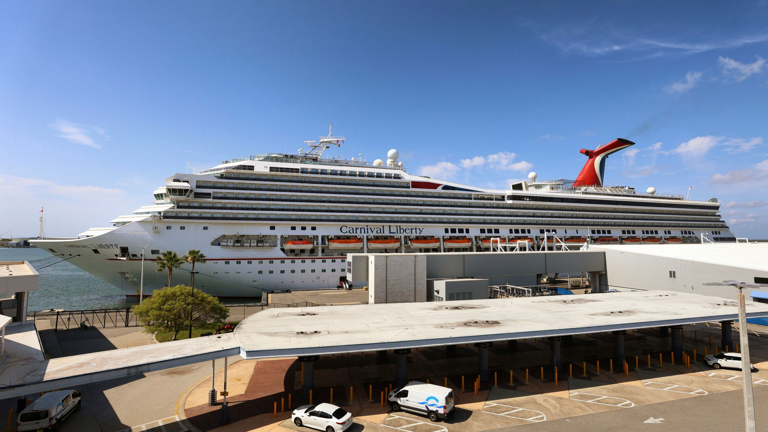 """FILE - In this Wednesday, May 12, 2021, file photo, the Carnival Cruise ship """"Liberty"""" is docked at Port Canaveral, Fla., as crew members get vaccinated for COVID-19. Customers and employees of several Carnival Corp. cruise lines might have had personal information stolen. The Miami-based company said Thursday, June 17, that a data breach in March might have exposed things like Social Security numbers and dates of birth for some customers, employees and ship crew members on Carnival Cruise Line, Holland America Line and Princess Cruises. (Joe Burbank/Orlando Sentinel via AP, File)"""