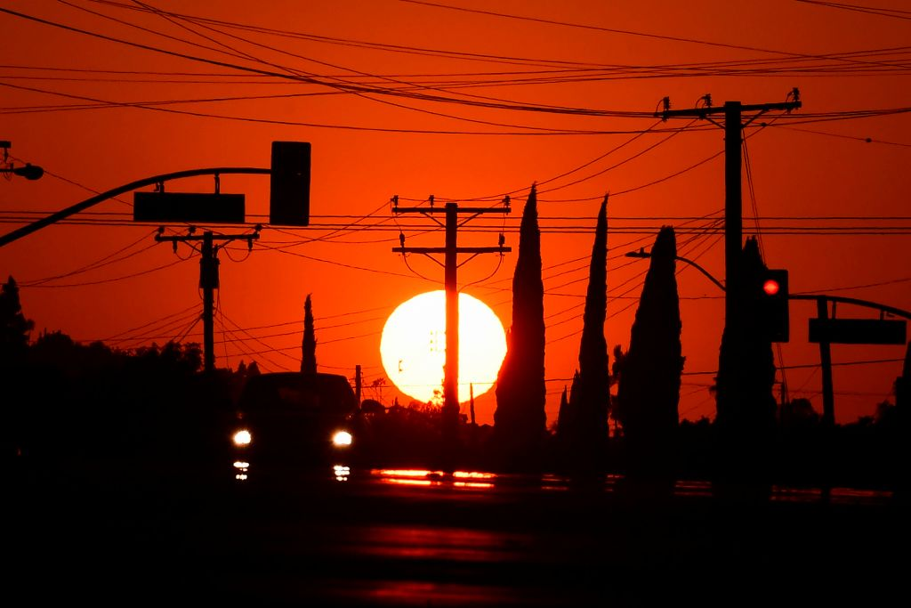 he sun sets behind power lines in Los Angeles, California on September 3, 2020, ahead of a heatwave to arrive September 4 through the Labour Day weekend prompting a statewide flex alert. (Photo by Frederic J. BROWN / AFP) (Photo by FREDERIC J. BROWN/AFP via Getty Images)