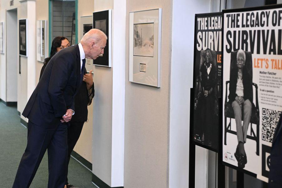 image of US President Joe Biden listens to Michelle Brown-Burdex