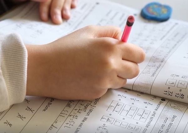 A student works on a math book in a school classroom (Nexstar, file)