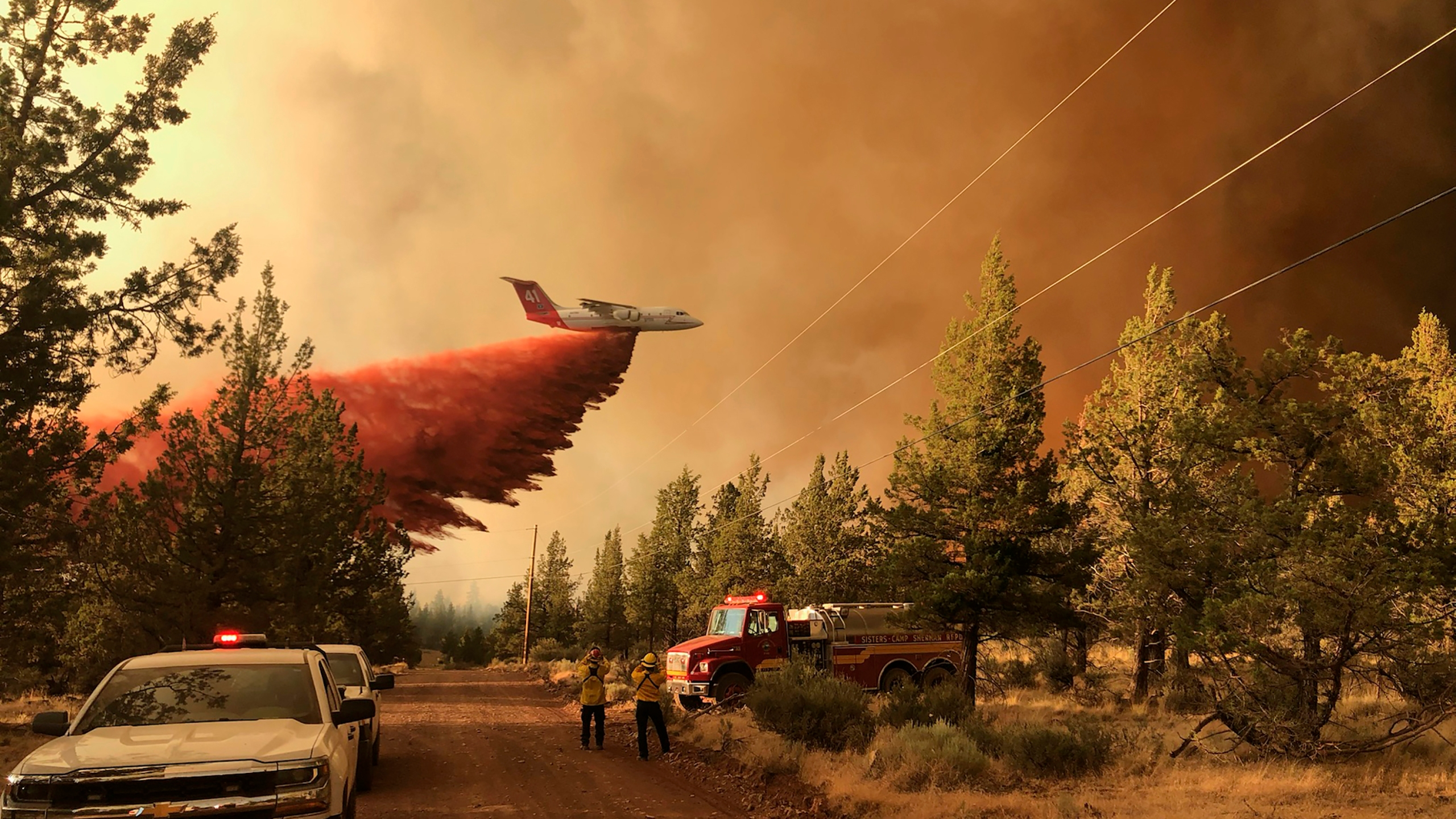 A firefighting tanker making a retardant drop over the Grandview Fire