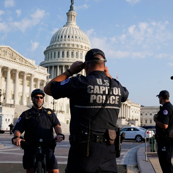 he U.S. Capitol is seen in Washington, early Tuesday, July 27, 2021, as U.S. Capitol Police watch the perimeter. Democrats are launching their investigation into the Jan. 6 Capitol insurrection. They're beginning with a focus on the law enforcement officers who were attacked and beaten as the rioters broke into the building. It's an effort to put a human face on the violence of the day. The police officers who are testifying Tuesday endured some of the worst of the brutality. The panel's first hearing comes as partisan tensions have only worsened since the insurrection. Many Republicans have played down or outright denied the violence that occurred and denounced the Democratic-led investigation as politically motivated. (AP Photo/J. Scott Applewhite)