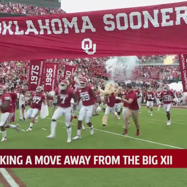 OU Sooners football team runs onto the field