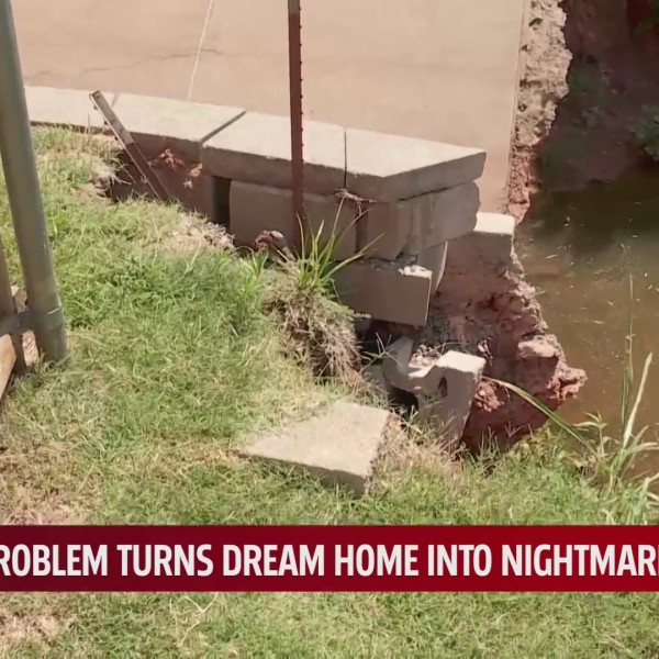 A drainage wall that has begun to crumble in the Greenbriar Pointe neighborhood