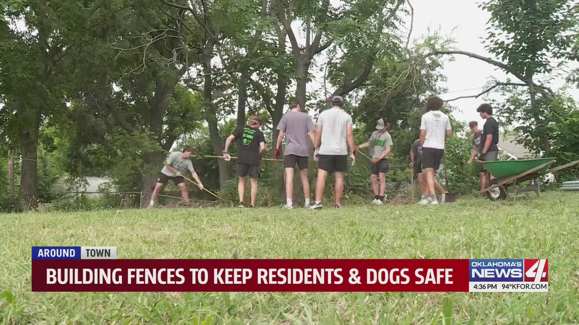 group of volunteers dig holes for fence posts in Oklahoma City midtown neighborhood