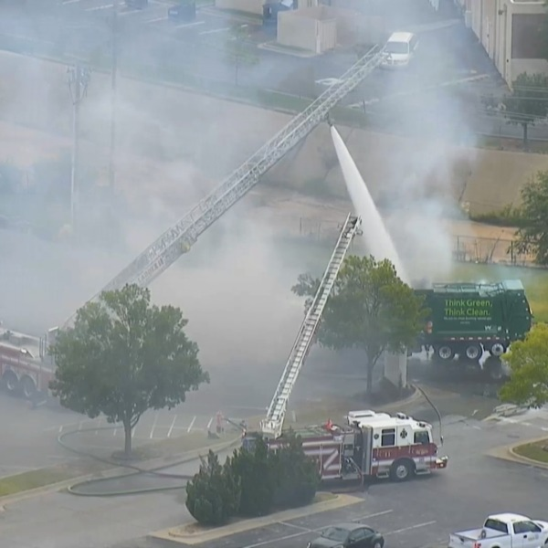 Image of fire trucks putting out garbage truck blaze