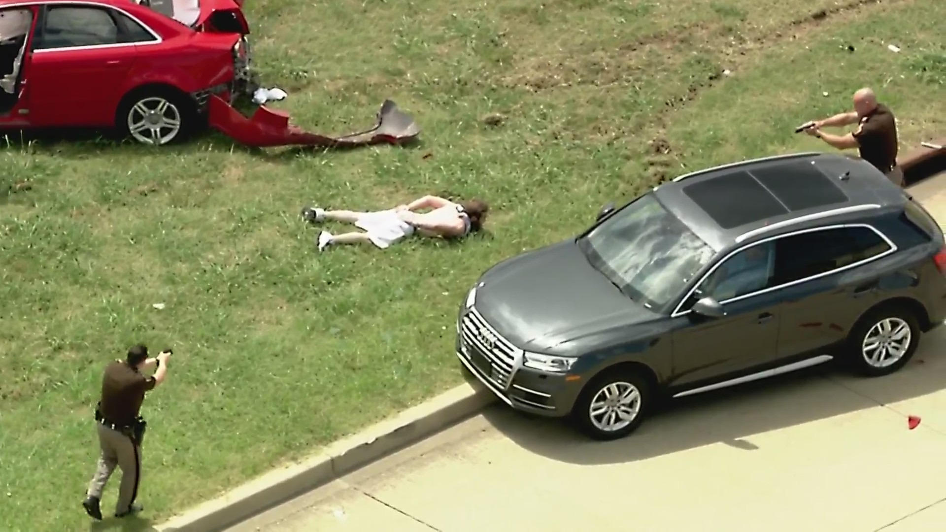 image of suspect on the ground after high speed chase