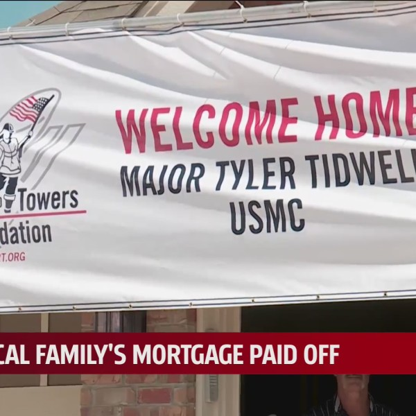 Sign welcoming home Major Tyler Tidwell's family