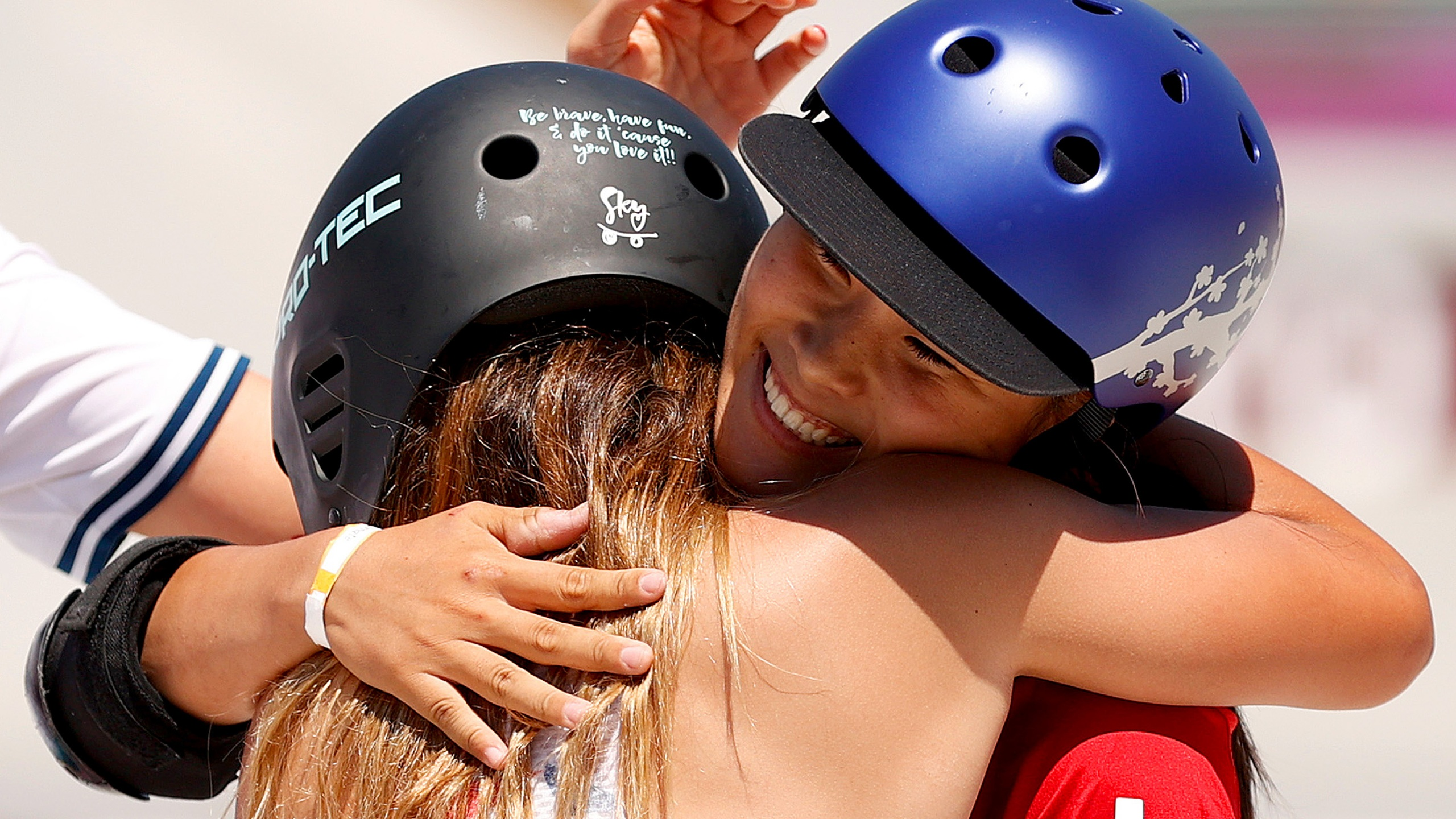 image of athletes hugging
