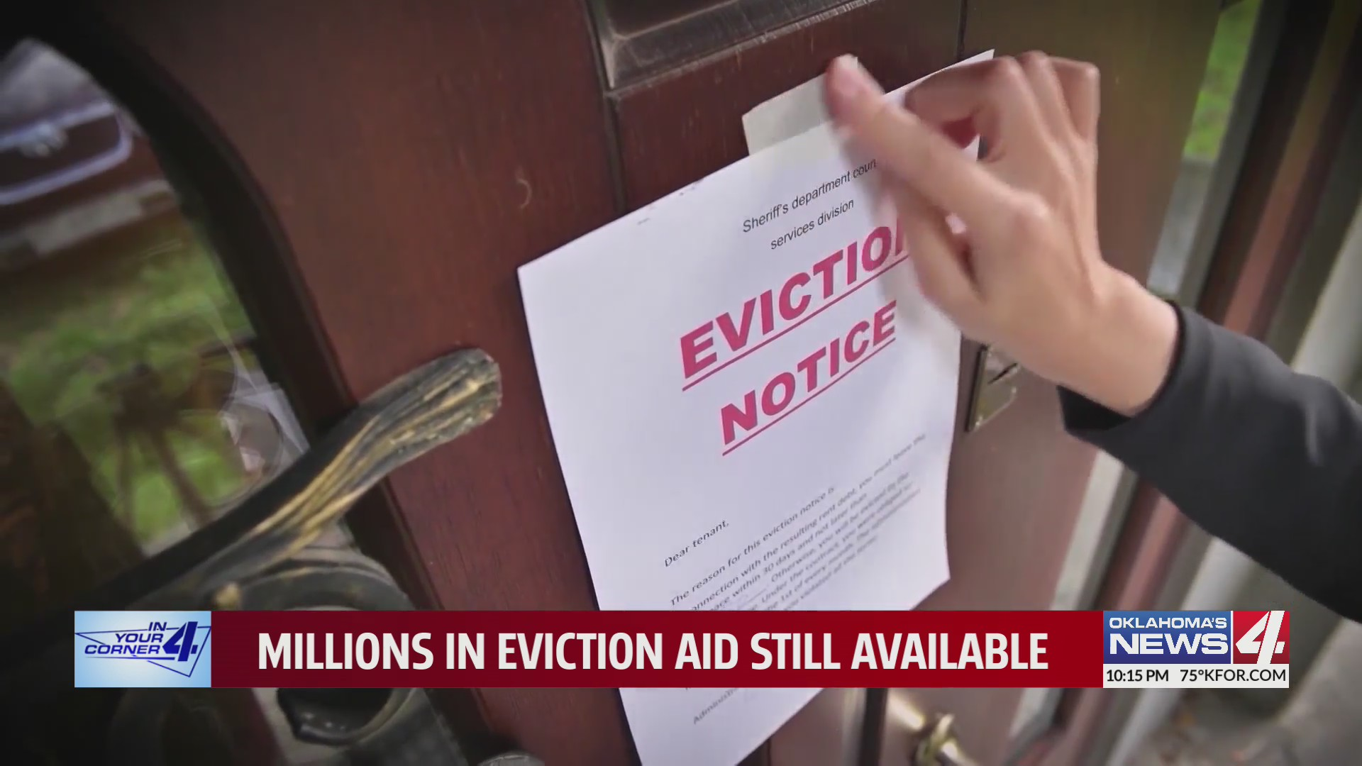 Hand tapes eviction notice to door