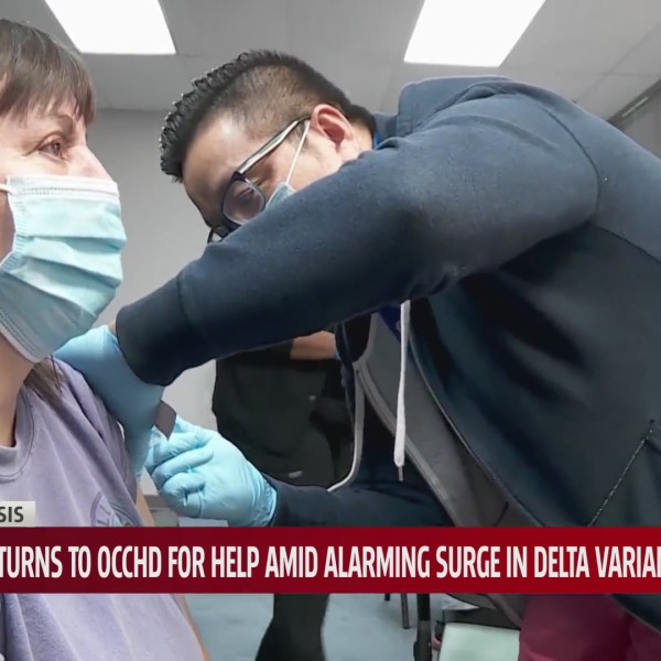 Healthcare worker administers vaccine to woman
