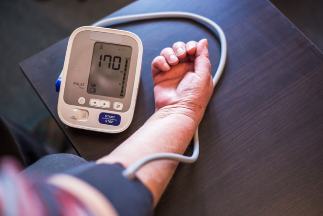 at-home blood pressure monitor in use on arm