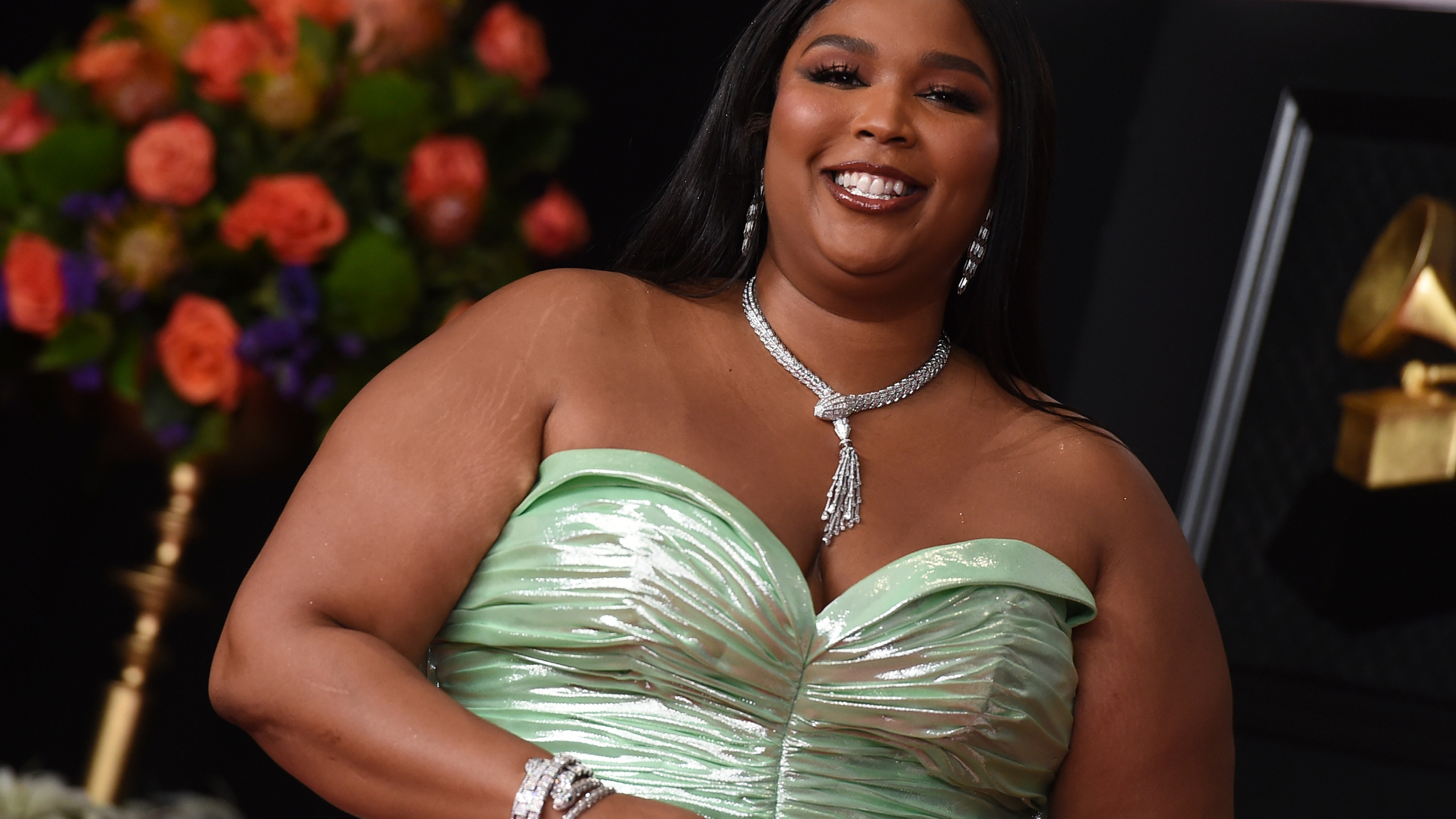 Lizzo arrives at the 63rd annual Grammy Awards at the Los Angeles Convention Center on Sunday, March 14, 2021. (Photo by Jordan Strauss/Invision/AP)