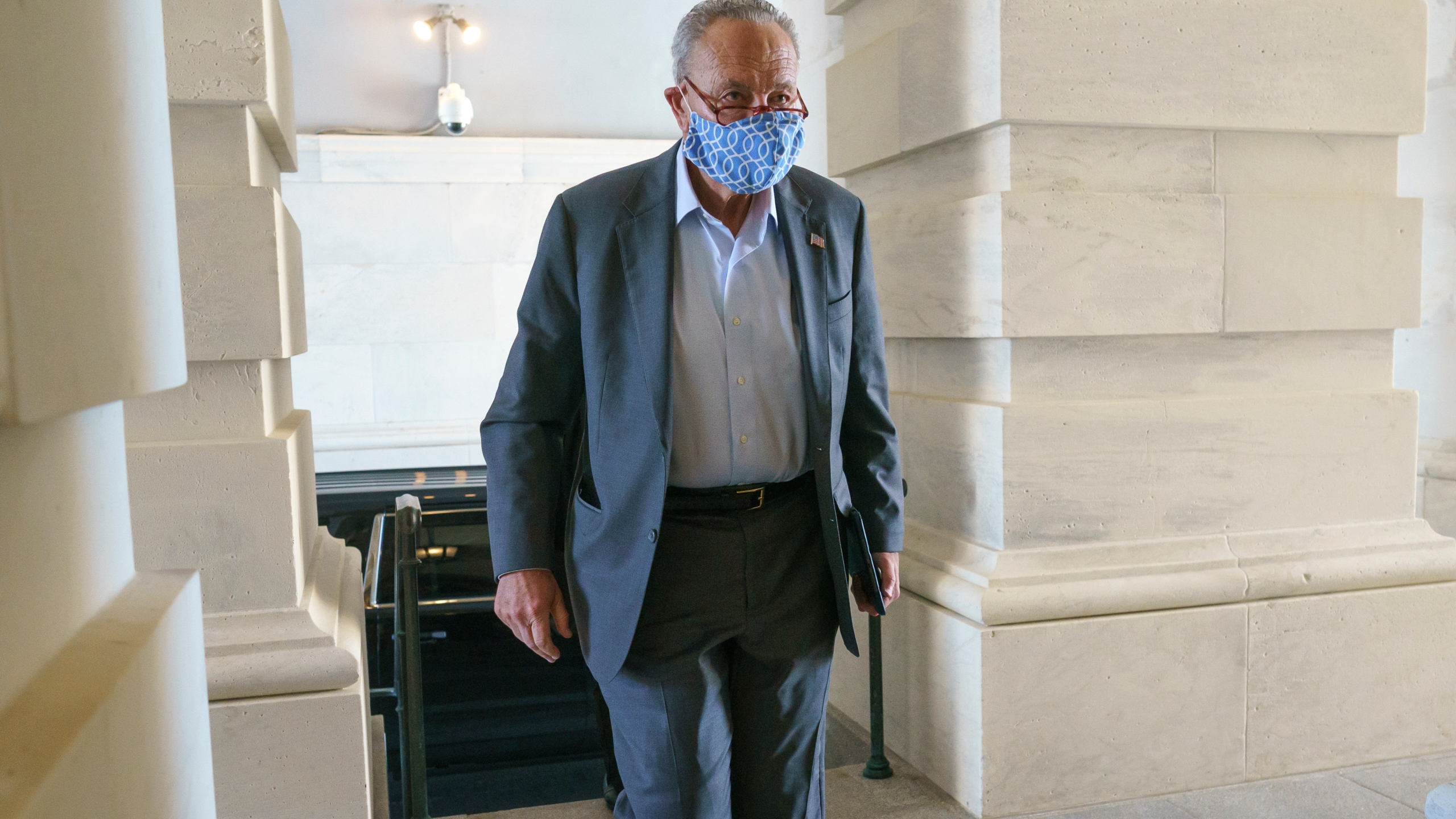 Senate Majority Leader Chuck Schumer, D-N.Y., arrives at the Capitol in Washington, Thursday, Sept. 30, 2021. Schumer is preparing for a morning vote to temporarily fund the government while President Joe Biden appears unable to strike swift agreement with two wavering Democrats, Sen. Joe Manchin, D-W.Va., and Sen. Kyrsten Sinema, D-Ariz., over his big $3.5 trillion government overhaul. (AP Photo/J. Scott Applewhite)