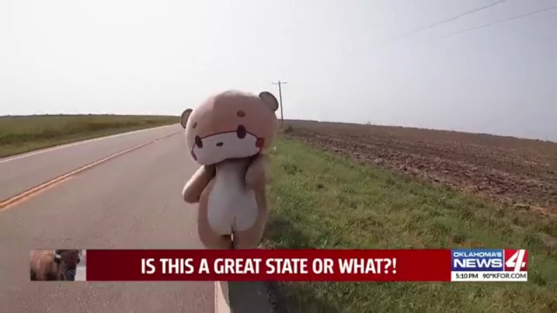 Bearsun walks Highway 11 near Deer Creek, Oklahoma