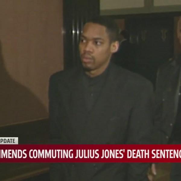 Julius Jones walks through courthouse