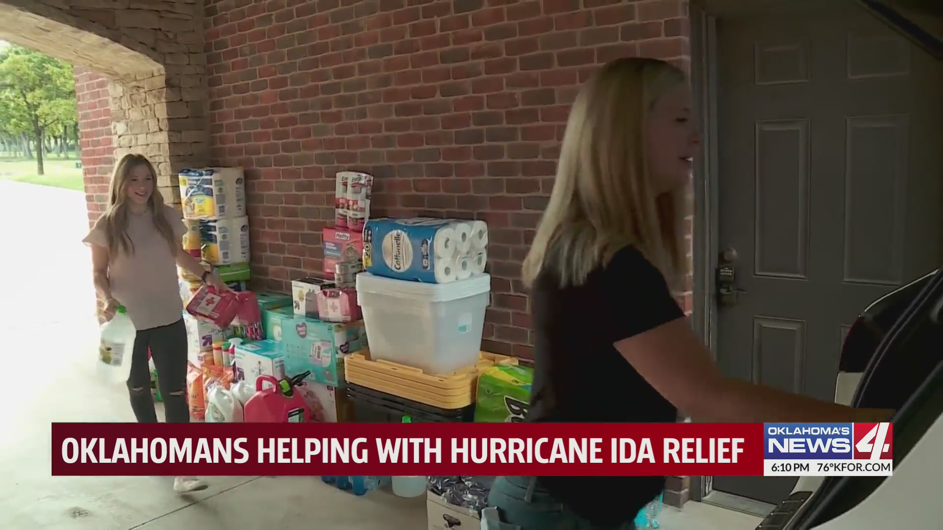 Erin Glomset and Carly McDavid pack care full of supplies for displaced Louisianans following Hurricane Ida
