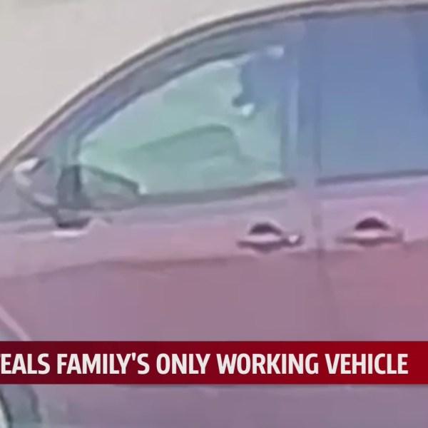 Surveillance video shows suspect in stolen vehicle