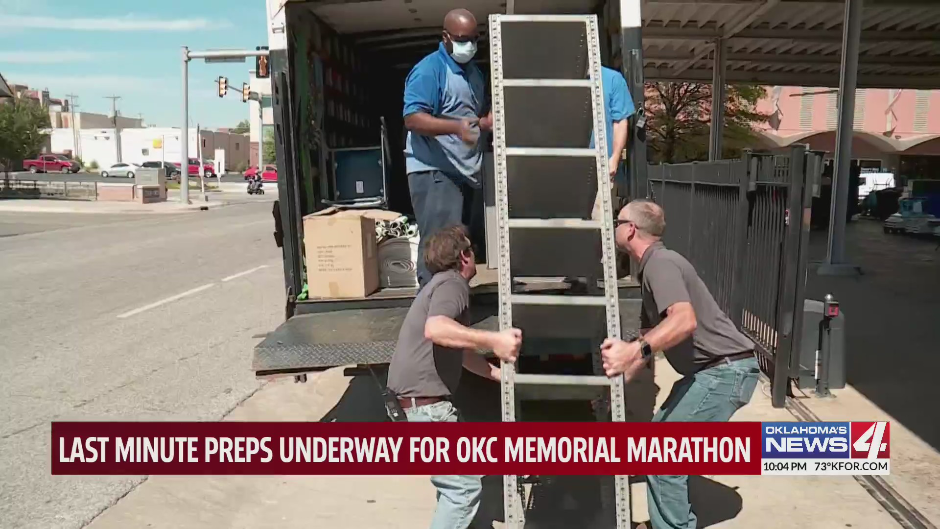 Men lift column into truck during Oklahoma City Memorial Marathon preparations