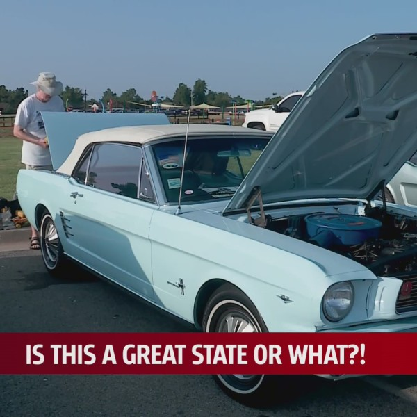 Man checks out Ford Mustang on display at show in Mustang, Oklahoma