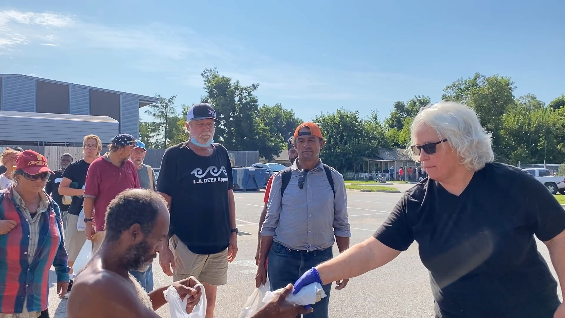 Denise Dickson hands out food at The Homeless Alliance