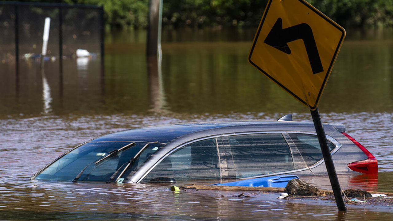 A car flooded on a local street as a result of the remnants of Hurricane Ida is seen in Somerville, N.J. Thursday, Sept. 2, 2021. (AP Photo/Eduardo Munoz Alvarez)