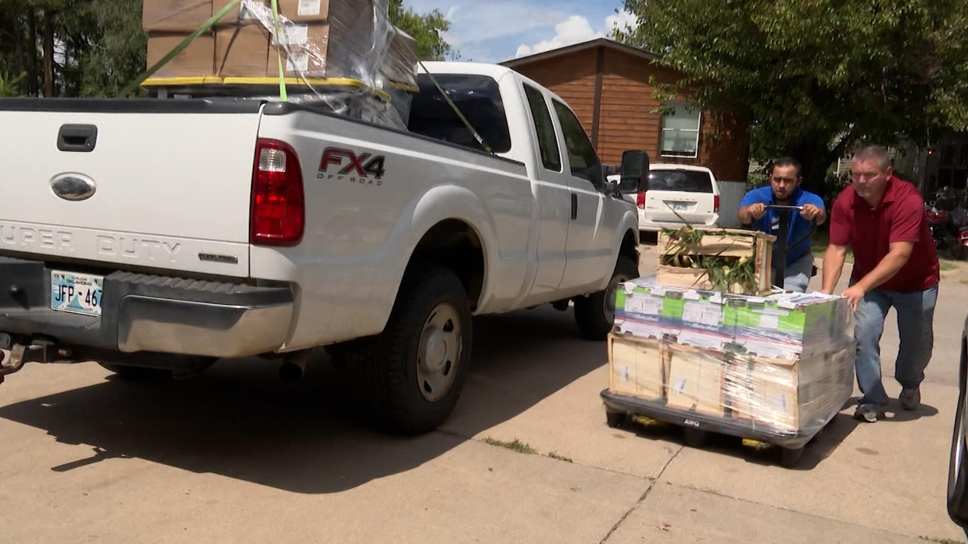 Volunteers deliver food to Riverside Community