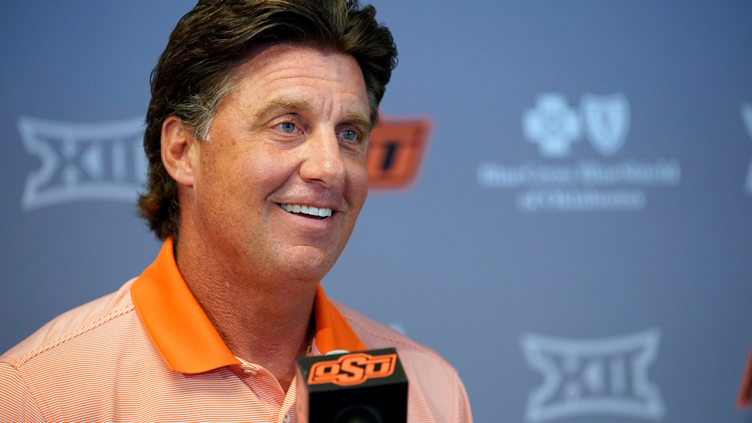 Oklahoma State head coach Mike Gundy answers questions during an NCAA college football news conference Thursday, Aug. 26, 2021, in Stillwater, Okla.