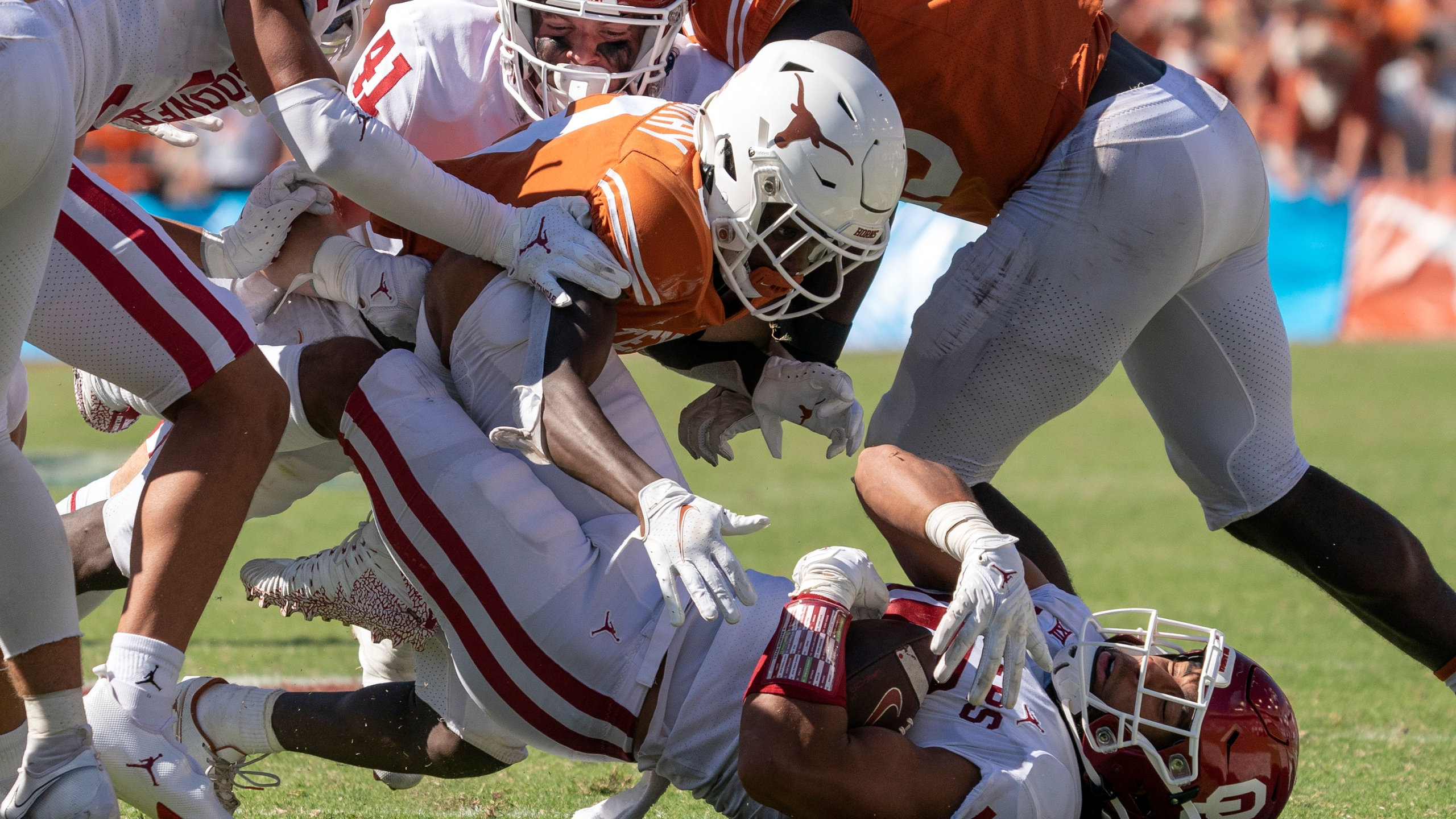 Oklahoma linebacker Caleb Kelly (19) falls to the ground after stripping the ball from Texas kick returner Xavier Worthy (8) on a kickoff during the second half of an NCAA college football game at the Cotton Bowl, Saturday, Oct. 9, 2021, in Dallas. (AP Photo/Jeffrey McWhorter)