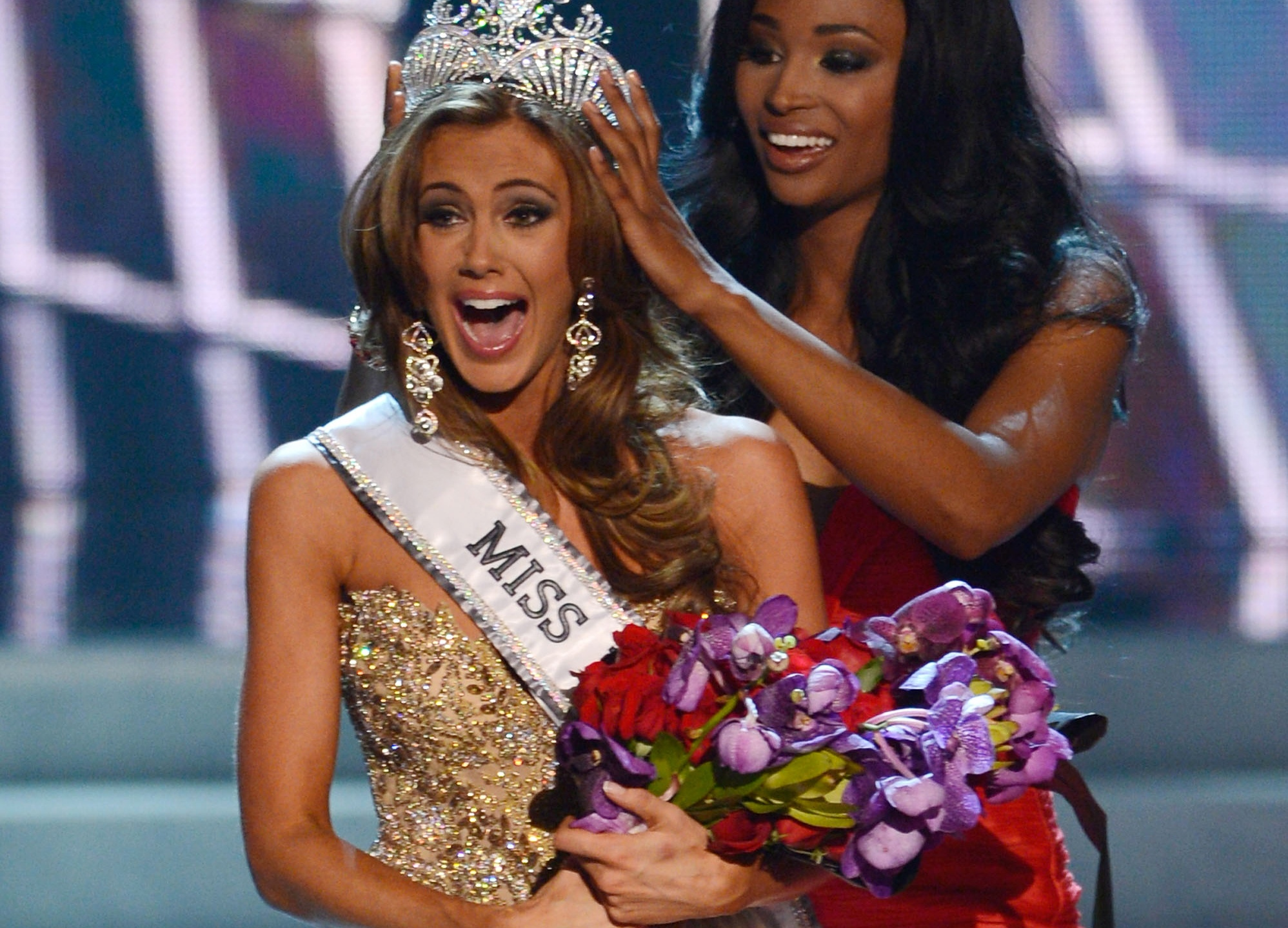 In this Sunday, June 16, 2013, file photo, Miss Connecticut Erin Brady is crowned the winner of the Miss USA 2013 pageant by Nana Meriwether in Las Vegas